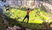 Daredevil leaps from clifftop with parachute affixed to piercings -